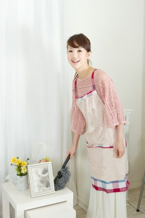 Beautiful woman cleaning in the room  Portrait of asian woman  photo