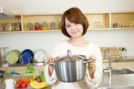 Beautiful woman standing in kitchen Stock Photo - 13100267