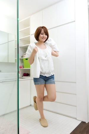 Beautiful young woman in a bathroom Stock Photo - 13100288