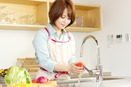 Beautiful woman standing in kitchen photo
