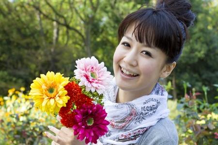 Beautiful asian woman in flower garden  Stock Photo