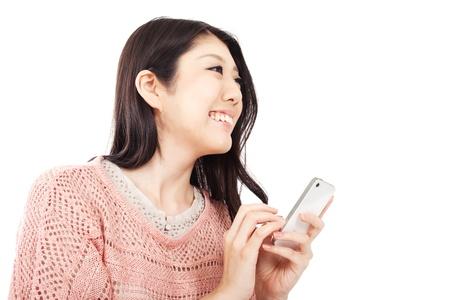Beautiful young woman using smart phone Stock Photo - 13406748