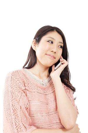 Beautiful young woman using smart phone photo