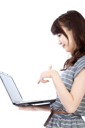 enjoy space: Beautiful young woman using a laptop computer