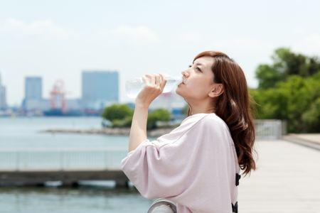 Beautiful young woman drinking water Stock Photo - 13665386