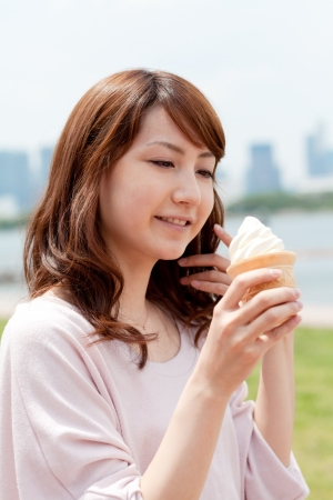 woman with ice cream: Beautiful young woman on beach summer holiday