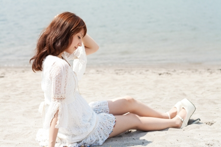 Beautiful young woman on beach summer holiday
