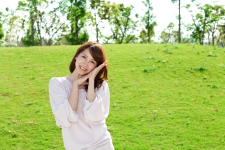 green life: Beautiful young woman on the green  Portrait of asian woman   Stock Photo