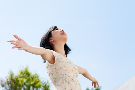 a serene life: Beautiful young woman outdoors over blue sky