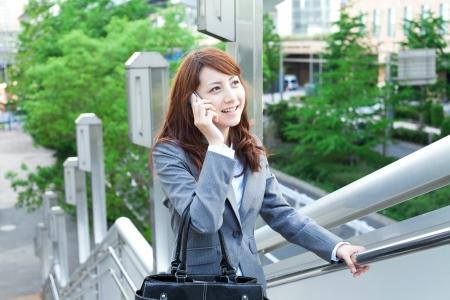 Beautiful business woman walking outside her office photo