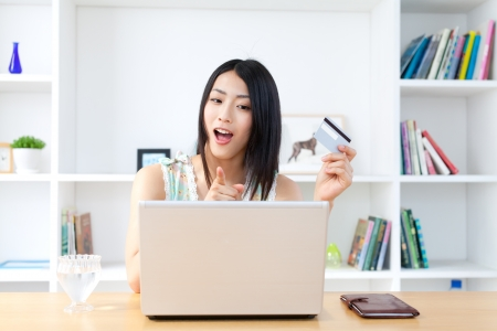 Beautiful asian woman using laptop computer   photo