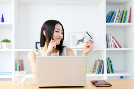 Beautiful asian woman using laptop computer  photo