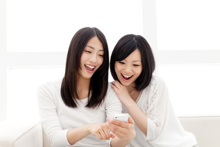 Beautiful young women using a moblie phone  Portrait of asian women   photo