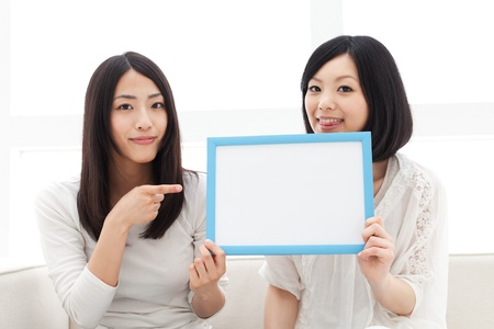 Beautiful young women with message board  Portrait of asian women   photo