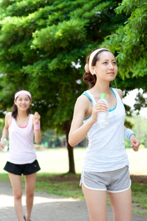 Beautiful young women running in park  Portrait of asian  photo