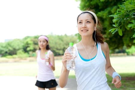 sports wear: Beautiful young women running in park  Portrait of asian