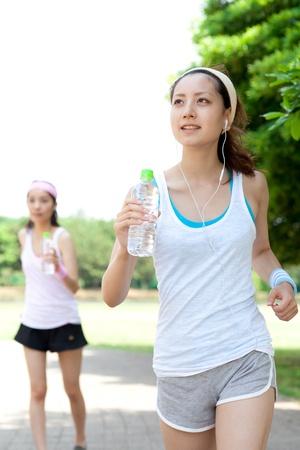 Beautiful young women running in park  Portrait of asian  photo