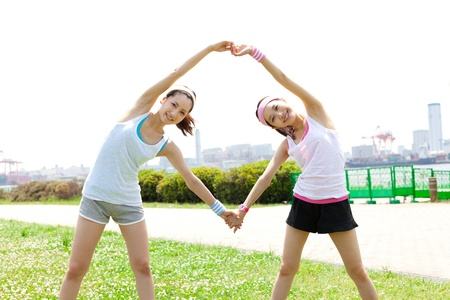 korean girl: Beautiful young woman doing stretching exercise in the park