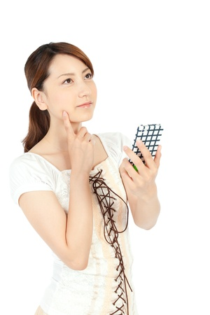 Beautiful young woman using a mobile phone Stock Photo - 14108176
