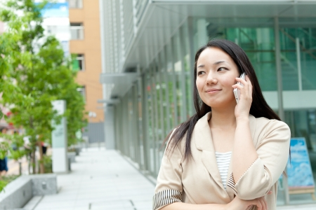 business woman phone: Beautiful business woman outdoor