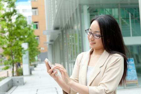 Beautiful business woman outdoor photo