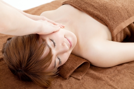 Beautiful young woman in spa photo