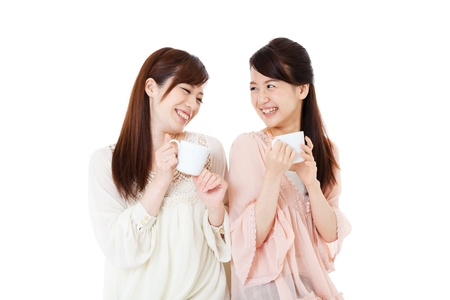 two friends talking: Beautiful young women drinking coffee