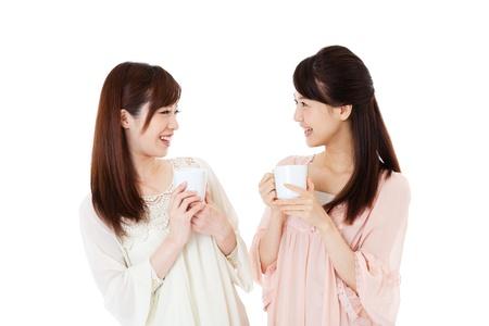 コーヒーを飲むの美しい若い女性 写真素材