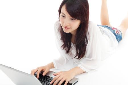 Beautiful young woman using a laptop  Portrait of asian  photo