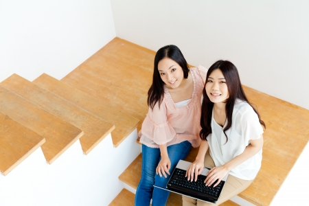 Beautiful young business women using a laptop computer photo
