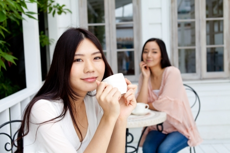 restaurant exterior: Beautiful young business woman drinking tea