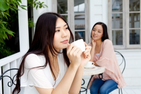 Beautiful young business woman drinking tea photo