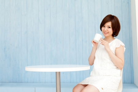 chinese adult: Beautiful young woman drinking tea Stock Photo