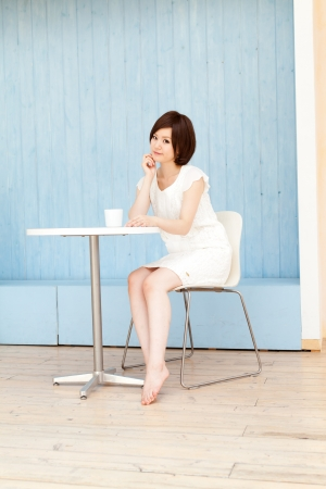 Beautiful young woman drinking tea photo