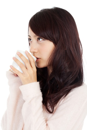 Beautiful young woman drinking coffee photo