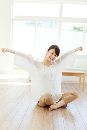 Beautiful young woman relaxing in the room  Portrait of asian
