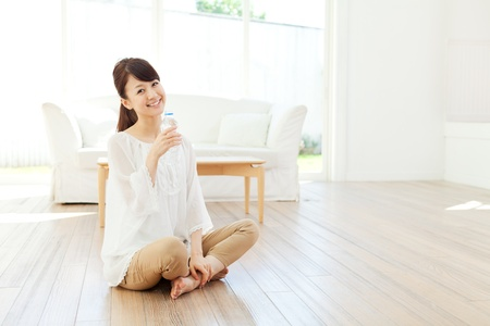 cold room: Beautiful young woman relaxing in the room  Portrait of asian
