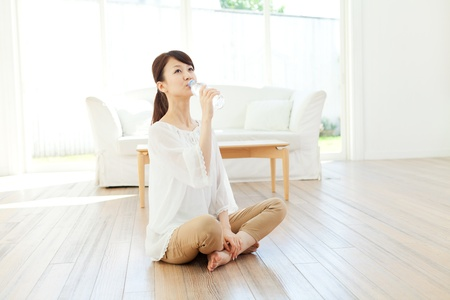 Beautiful young woman relaxing in the room  Portrait of asian  photo