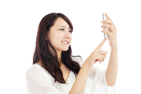 Beautiful young woman using a cellular  Portrait of asian  photo