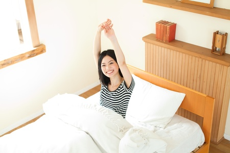 Beautiful young woman relaxing in the bedroom  Portrait of asian woman  photo