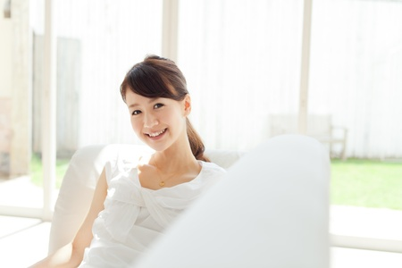 Beautiful young woman relaxing room  photo