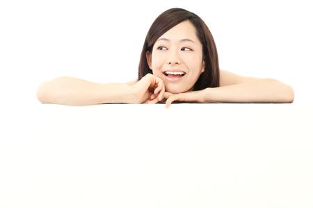 ホワイト ボードと美しい若い女性 写真素材