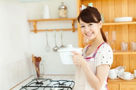 korean girl: Beautiful young woman relaxing iin the kitchen