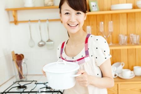 pan asian: Beautiful young woman relaxing iin the kitchen