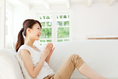 Beautiful young woman relaxing in the room Stock Photo - 15501815