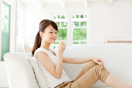 tea break: Beautiful young woman relaxing in the room Stock Photo