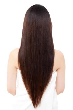白い背景の上の美しい髪の女性