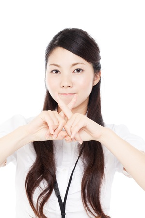 reject: Beautiful young business woman showing hand gesture Stock Photo