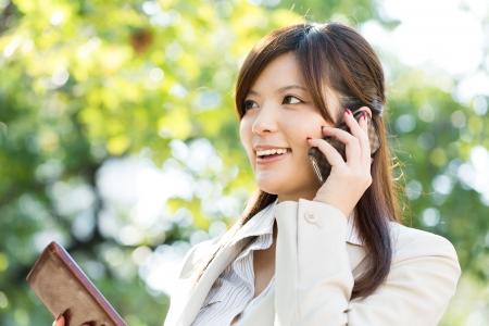 Beautiful businesswoman using a celluler phone Stock Photo - 15785114