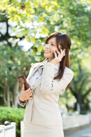 Beautiful businesswoman using a celluler phone photo
